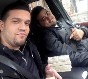 Photo credit: Handout | Elvis Rafael Rodriguez and Emir Yasser Yeje, both of Yonkers, are two of eight suspects in a cyber-hacking ring that stole $45 million in a few hours, the federal attorney in Brooklyn said. Investigators found this picture of the two suspects taken on a cellphone with $40,000 on the car seat. (May 9, 2013)
